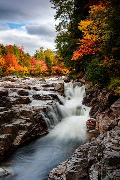 Swift river at rocky scenic gorge area during fall season