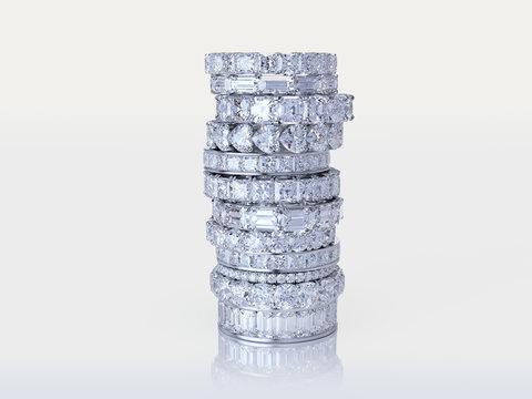 Stacked diamond eternity rings on white background