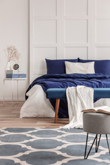 Simple navy blue and white bedroom interior design