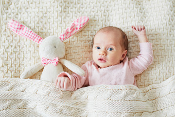 One month old baby girl with pink bunny