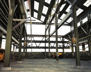 Large Interior grunge industrial warehouse with an empty open floor .3d rendering illustration