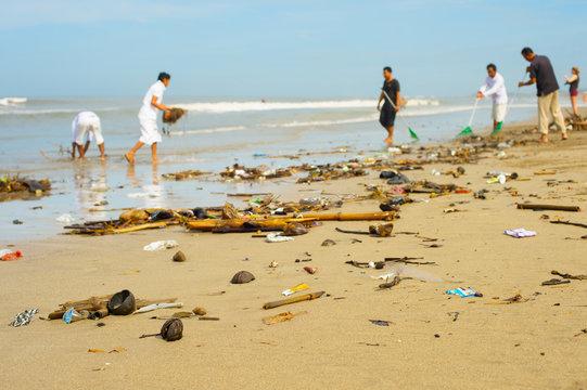 people cleaning ocean beach plastic