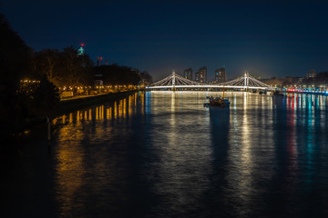 Battersea park and Albert bridge in the night, London