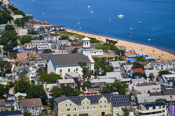 Looking down on city, beach and church of Provincetown, Cape Cod, Massachusetts, view from a tower