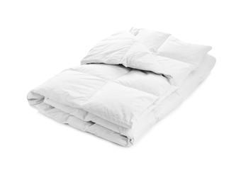 Folded soft blanket on white background. Textile for bedroom interior