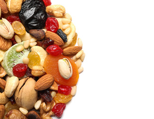 Different dried fruits and nuts on white background, closeup. Space for text