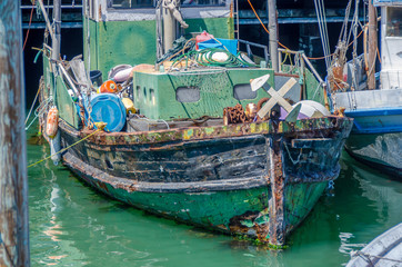 old green fishing boat in harbour