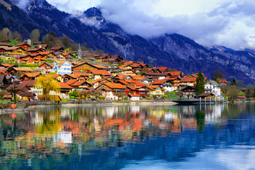 Old town and Alps mountains reflecting in lake, Switzerland