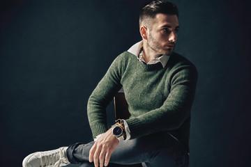Stylish handsome man portrait on dark background