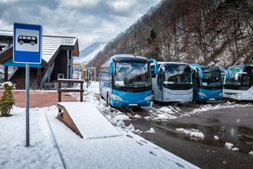 Bus station near the mountain forest at winter