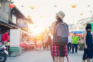 Woman traveling backpack,Asian traveler standing and walking in china town