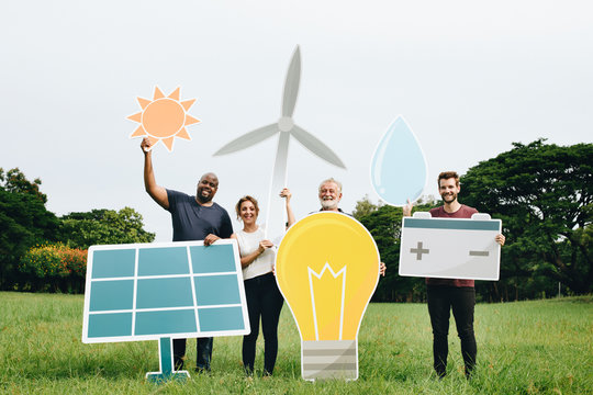 People holding energy saving icons