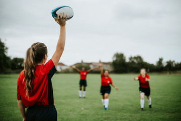 Female rugby player ready to throw the ball