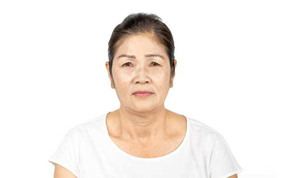 elderly asian woman portrait 60-70 years old isolated on white background