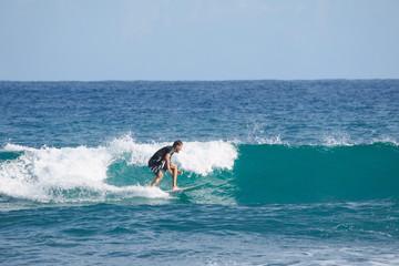 Surfer on blue Atlantic Ocean wave. Tropical winter.  Shortboard.
