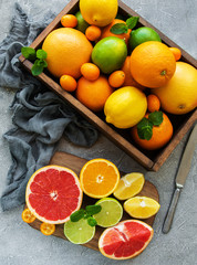 box with citrus fresh fruits on a concrete background