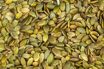 Peeled pumpkin seeds    pattern. Macro background texture of green pumpkin seeds