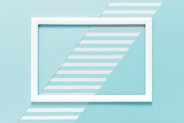 Abstract geometrical baby pastel blue flat lay background. Minimalism, geometry and symmetry template with empty picture frame mock up.