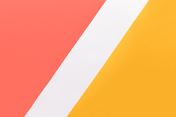 Abstract geometrical living coral, yellow and white paper flat lay background. Minimal, geometry...