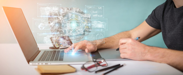 Graphic designer using wireframe holographic 3D digital projection of an engine