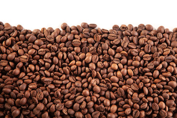Textured brown coffee beans on a white background.