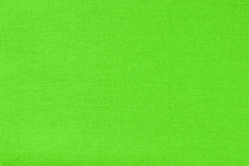 Green cotton fabric texture background, seamless pattern of natural textile.