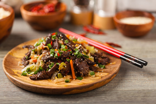 Traditional Korean Bulgogi dish.  Thinly cut, grilled beef, served with rice and vegetables.