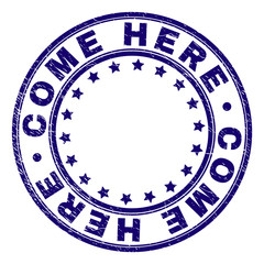 COME HERE stamp seal watermark with distress texture. Designed with round shapes and stars. Blue vector rubber print of COME HERE caption with corroded texture.
