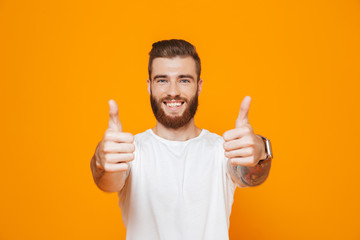 Portrait of a cheerful young man wearing casual clothes Wall mural