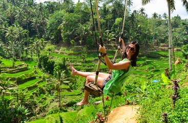 Bali swinging over Terrace rice fields in the morning, Ubud, Bali, Indonesia