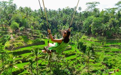 Bali swinging over Terrace rice fields in the morning, Ubud, Bali, Indonesia