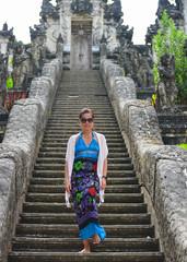 Young tourist visiting Lempuyang Temple, Bali Indonesia