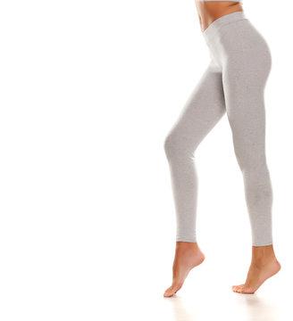 Sporty gray leggings on slim pretty legs