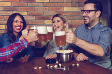 Two couples went on a double date to pub on a saturday night.