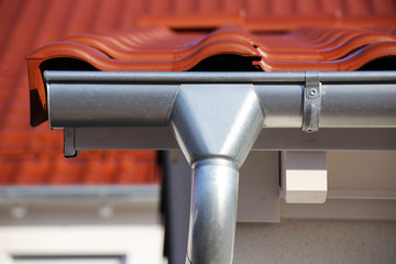 Roof gutter on a new tiled roof