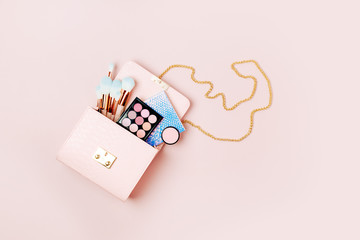 Wall Mural - Makeup bag with cosmetic beauty products. Flat lay, top view. Beauty and Fashion concept .