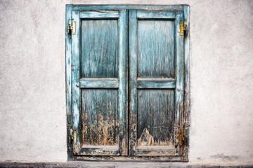 Old wooden window shutter in Italy.