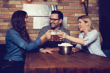 Group Of Friends Enjoying Evening Drinks In Bar