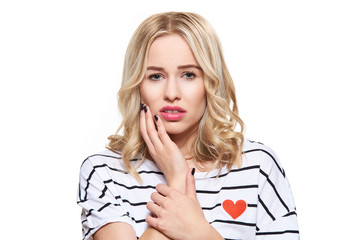 Young Woman Suffering From Toothache. Tooth Pain And Dentistry background. Beautiful Young Woman Suffering From Terrible Teeth Pain, Touching Cheek With Hand.