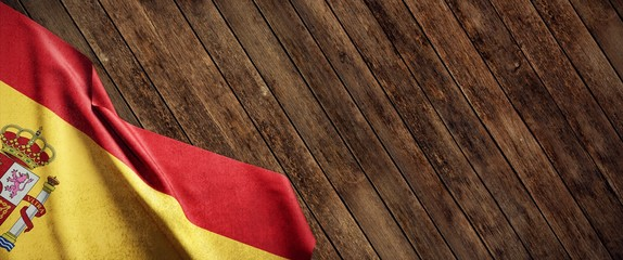 Spain, cloth flag on wood