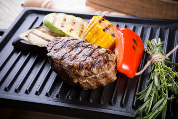 Cooked beef steak on a metal electric grill