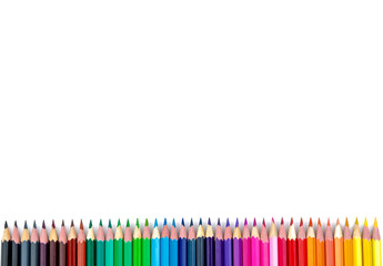 Many color pencils on white isolated background. close-up. view from above. stationery. space for text