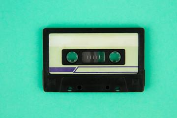 Retro cassette tape a on bright green  background