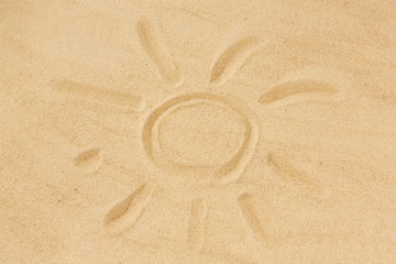summer vacation concept - picture of sun in sand on beach