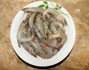 King raw prawns in the bowl on the marble table