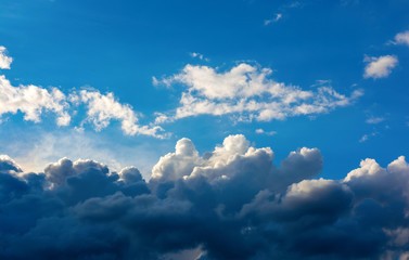Photo of a blue sky with dark clouds