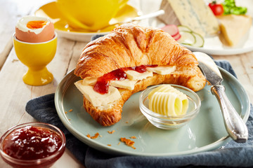 Croissant filled with cheese and ketchup