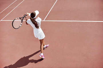 Waiting for the return. Young woman play tennis