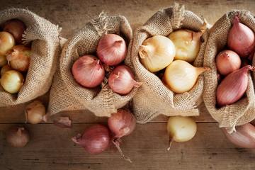 Fototapeta Top view of sack cloth bags with onion obraz