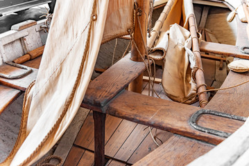 Sailing rowing wooden fishing boat. Inside view.